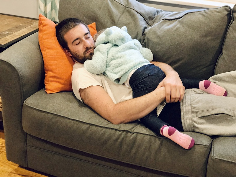 Dad with toddler sleeping on his chest