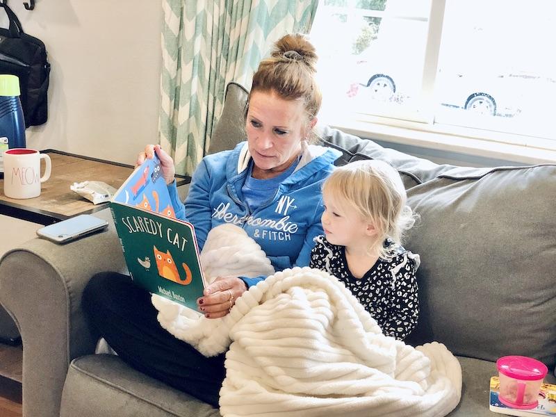 Grandma reading Usborne book to toddler