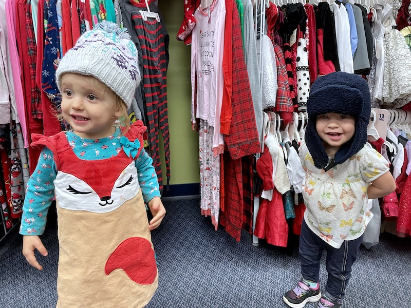 Toddlers in clothing store with hats on