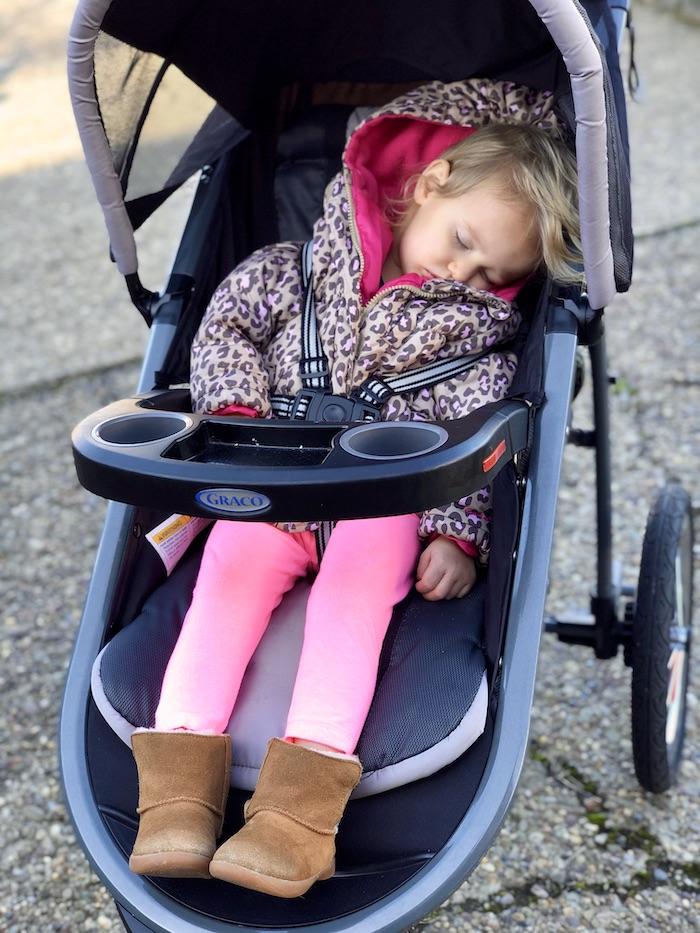 Toddler sleeping in Graco stroller