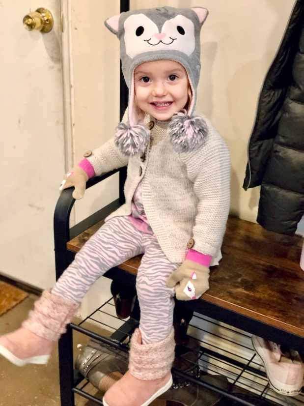 Toddler wearing cat hat