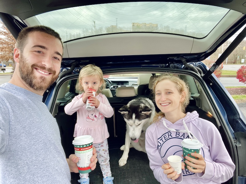 Family drinking Starbucks coffee with dog