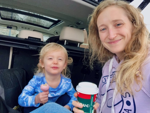 Mom and toddler with Starbucks