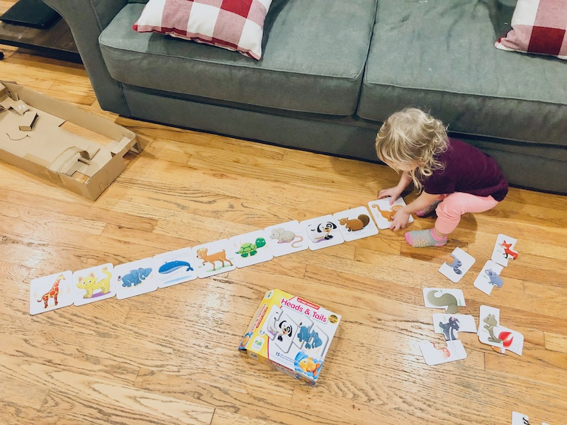 Toddler playing with self-correcting matching puzzle game