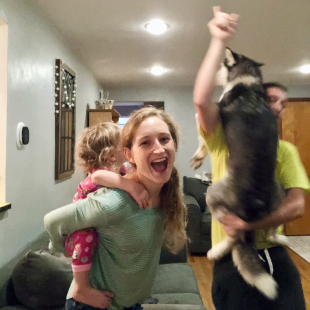 Family dance party with husky