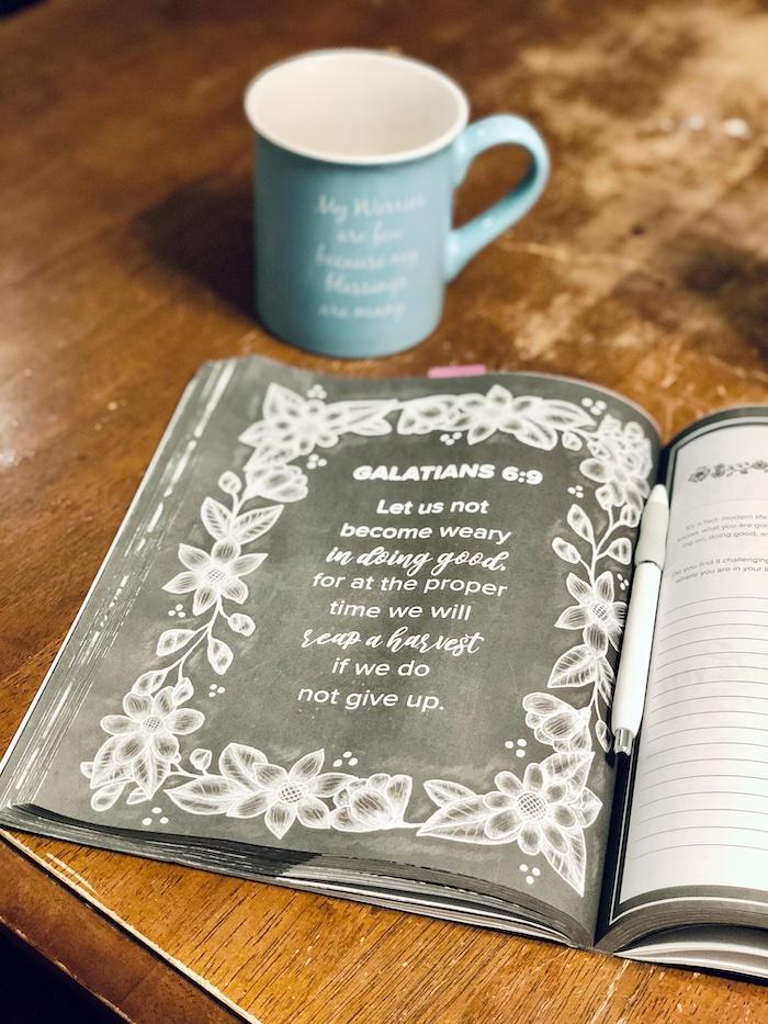 Prayer journal and coffee