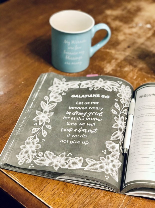 Prayer journal and coffee