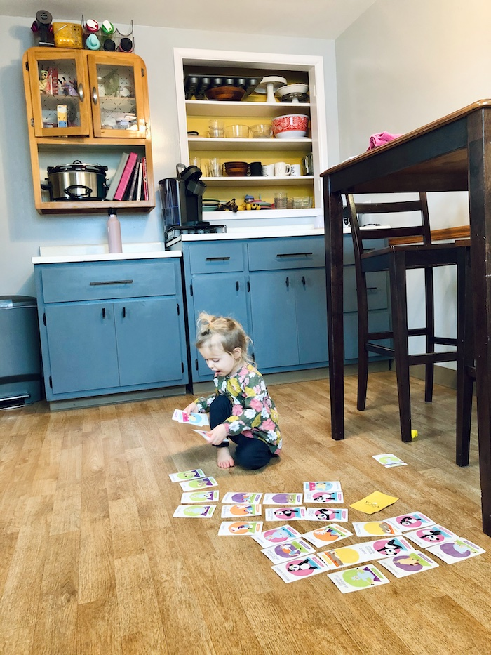 Toddler playing with yoga cards
