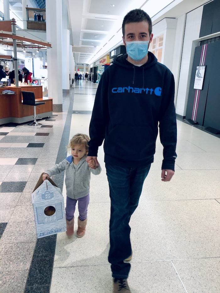 Father and daughter walking at mall with Build-A-Bear box in Pittsburgh, PA