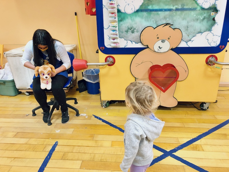 Toddler at Build-A-Bear making a Skye from Paw Patrol