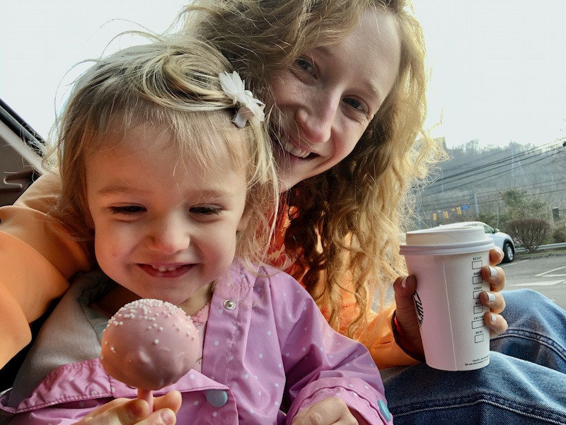 Toddler with cake pop from Starbucks
