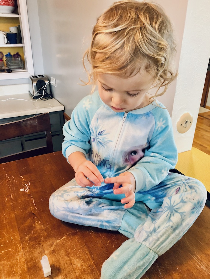 Toddler painting her nails