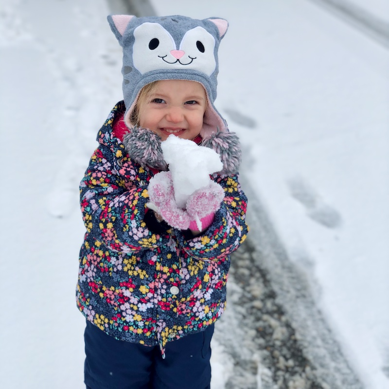 Toddler holding snowball