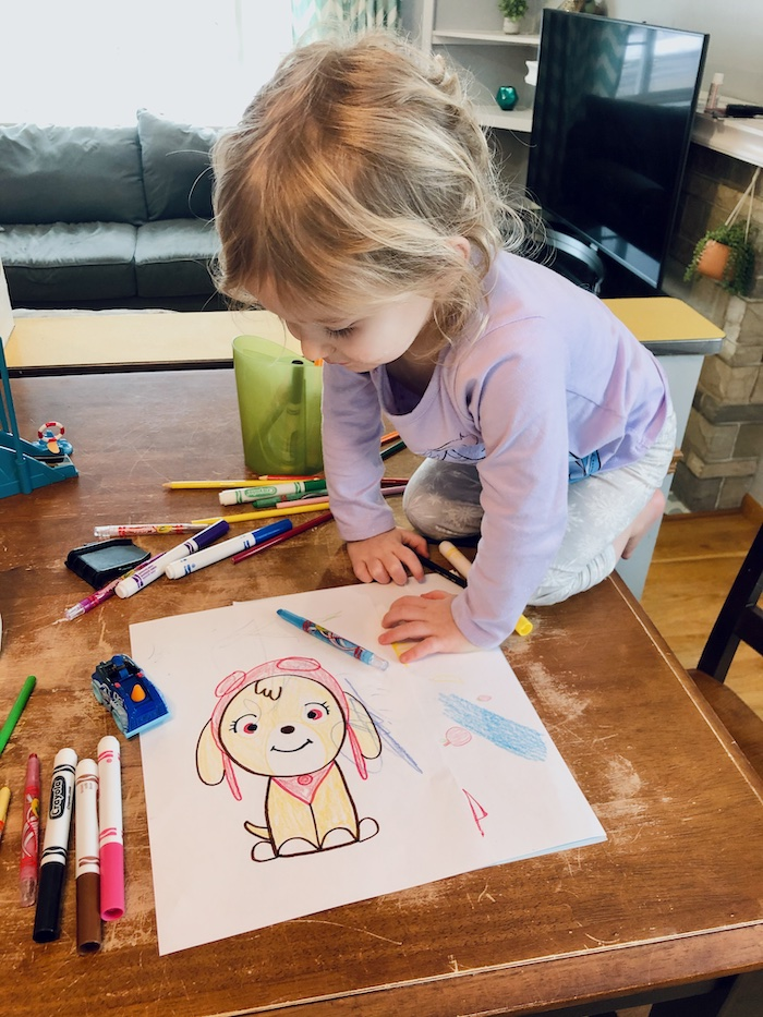 Toddler with Paw Patrol Drawing