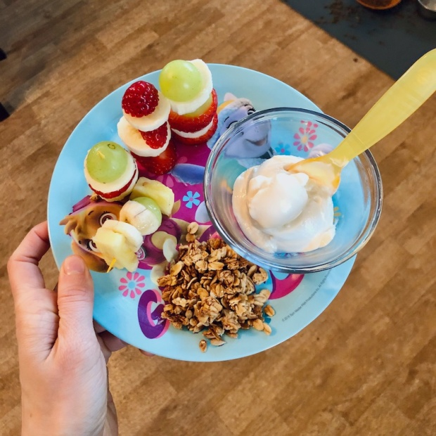 Toddler breakfast with fruit, yogurt, and granola
