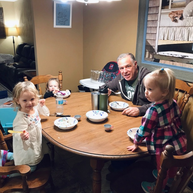 Grandpa with three toddler granddaughters