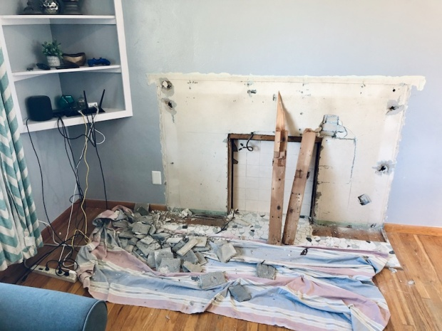 Fireplace and mantle demolition for renovation