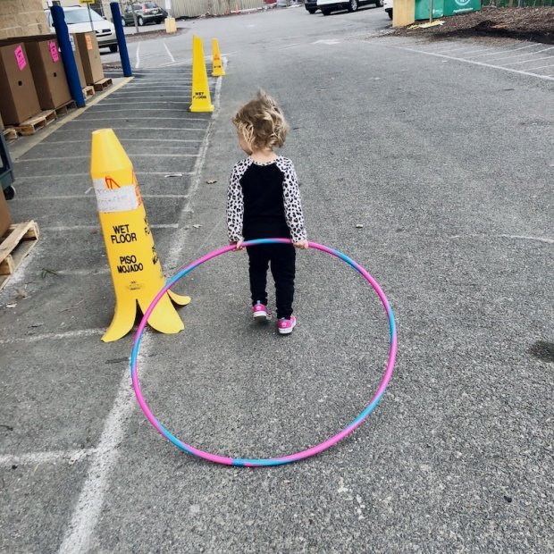 Toddler carrying hula hoop