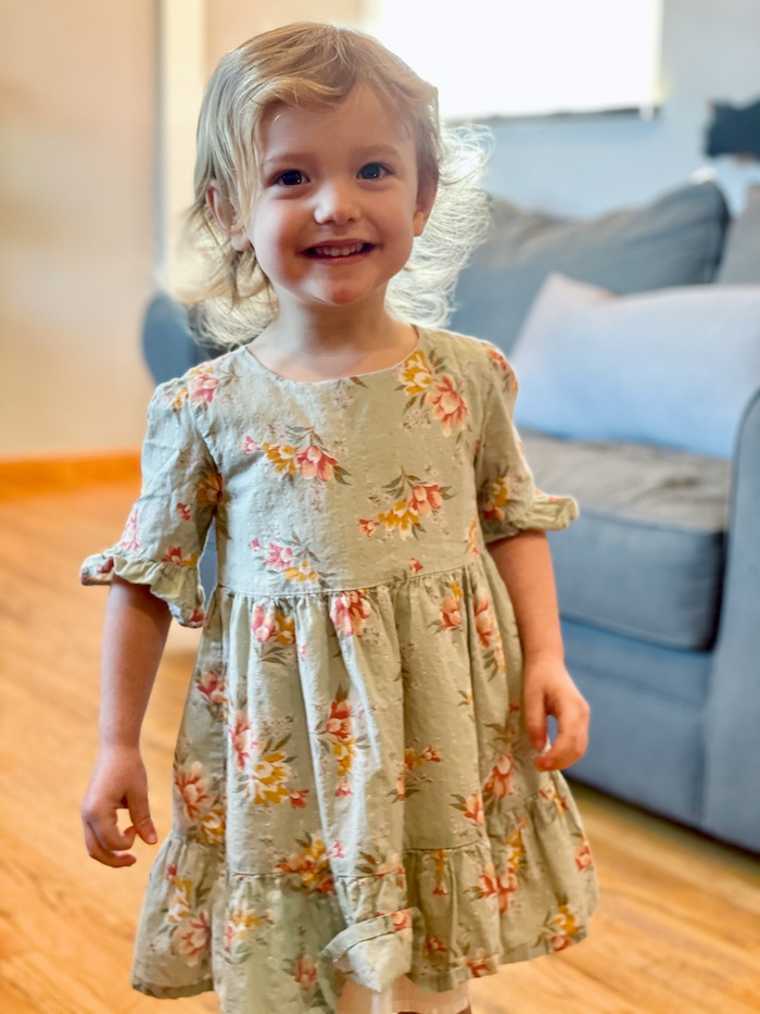 Toddler smiling in dress