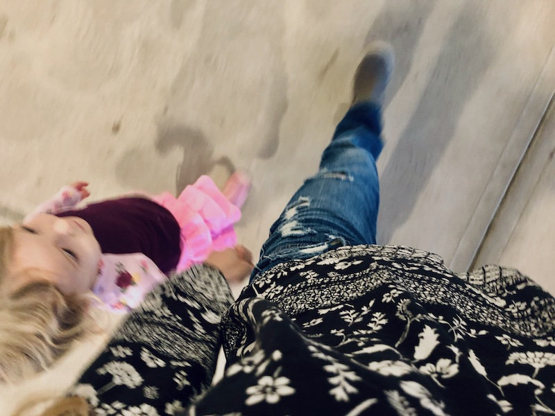Mom and toddler holding hands and walking