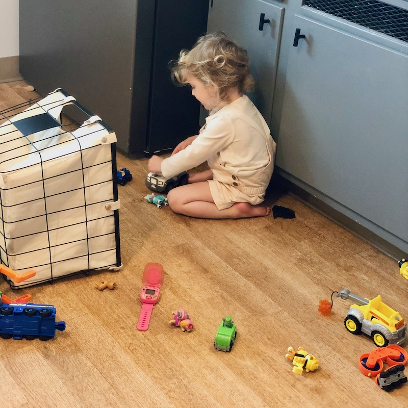 Toddler playing with Paw Patrol toys