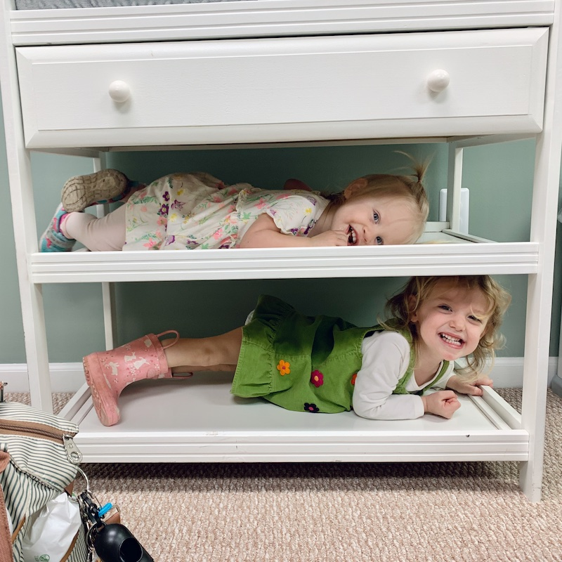Toddler girls on changing table like bunk beds