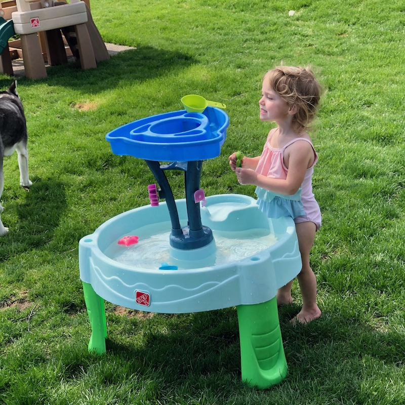 Toddler playing with Step 2 water table