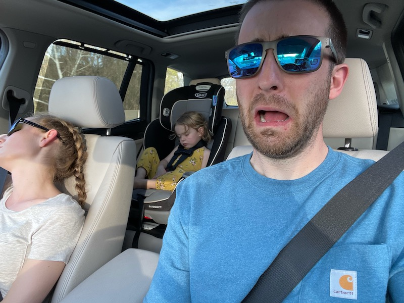 Mom and daughter sleeping in car while dad drives