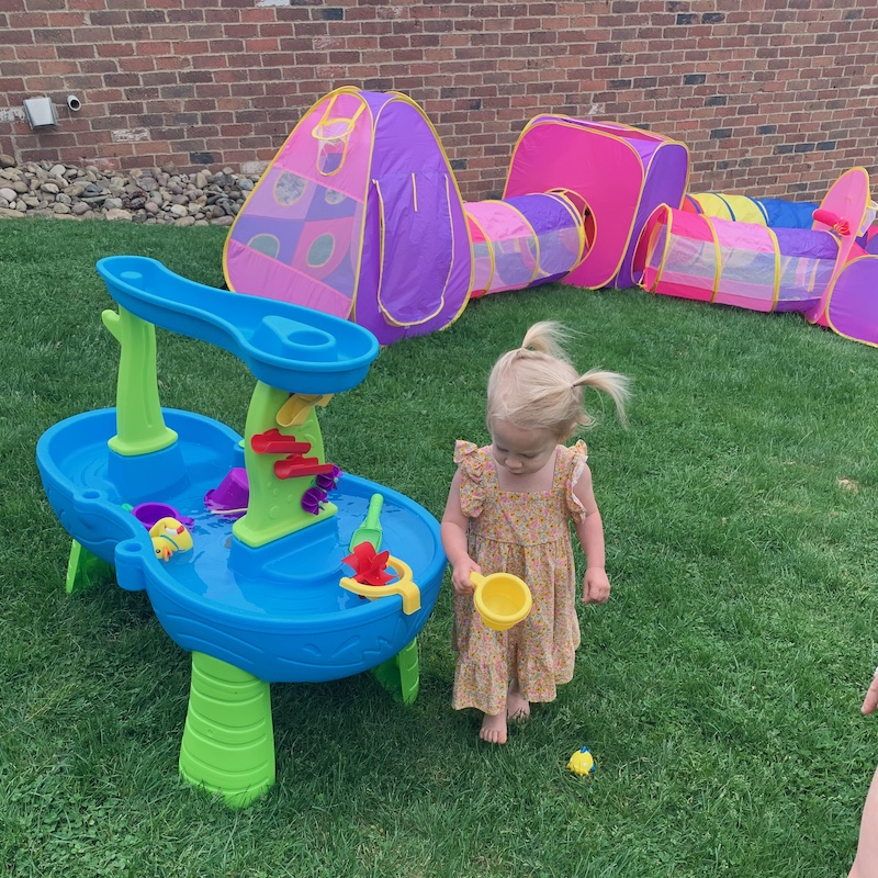 Toddler playing with water table