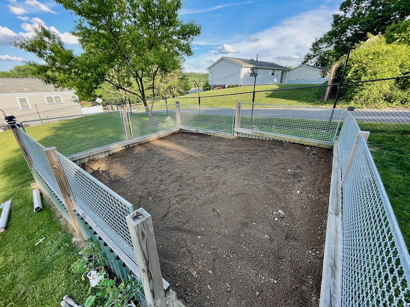 Vegetable garden plot with fence around it after being tilled in Pittsburgh, PA