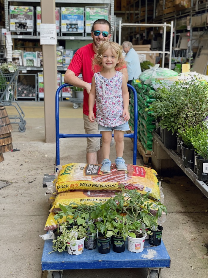 Father and daughter at Lowe's buying plants for garden