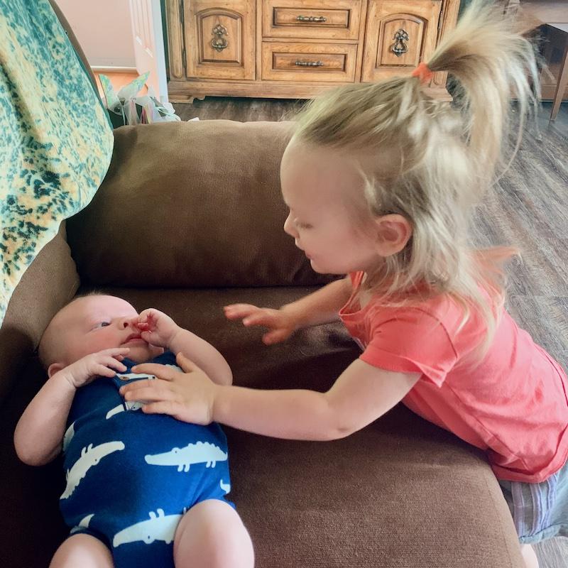 Toddler meeting baby boy