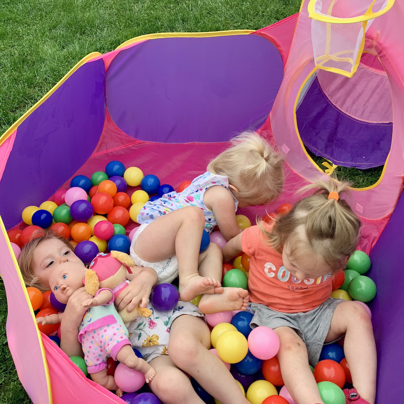 Toddlers playing in ball pit