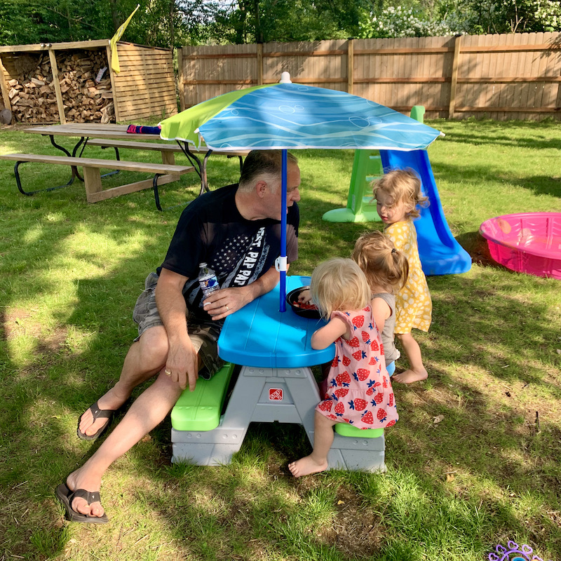 Grandpa with toddler granddaughters