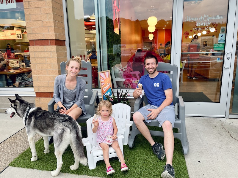 Family eating ice cream with dog at Millie's ice cream in Bridgeville, PA