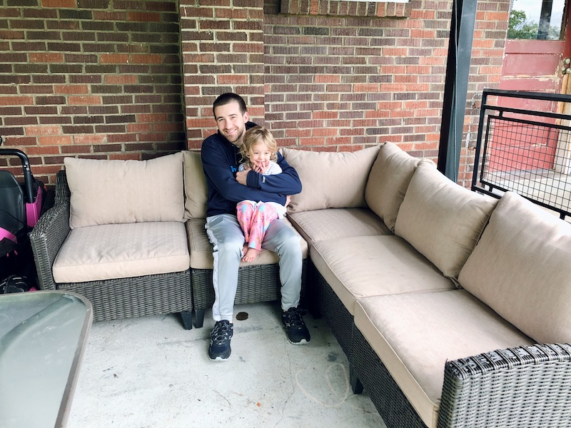 Dad and toddler sitting on outdoor furniture in Pittsburgh