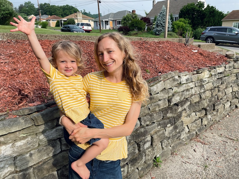 Mom and daughter wearing matching yellow shirts from Carter's