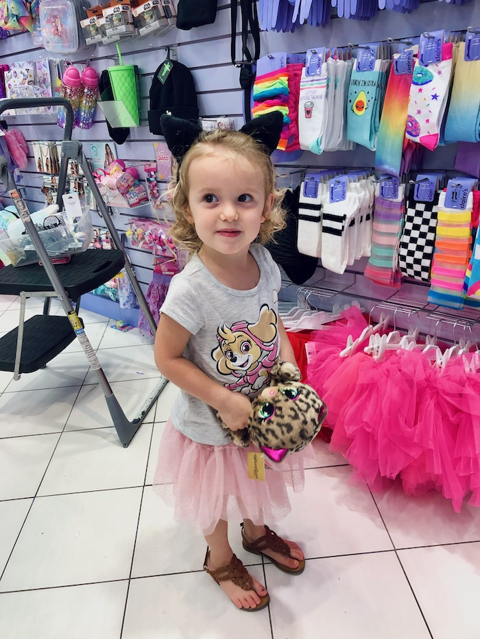 Little girl in Claire's store with cat ears headband