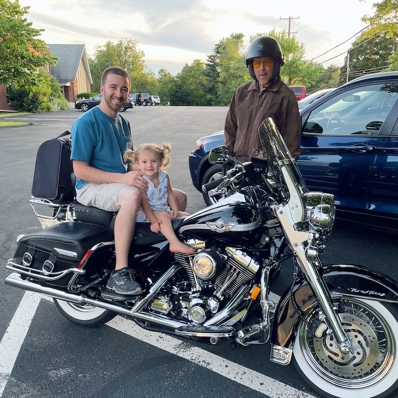 Father and toddler on motorcycle