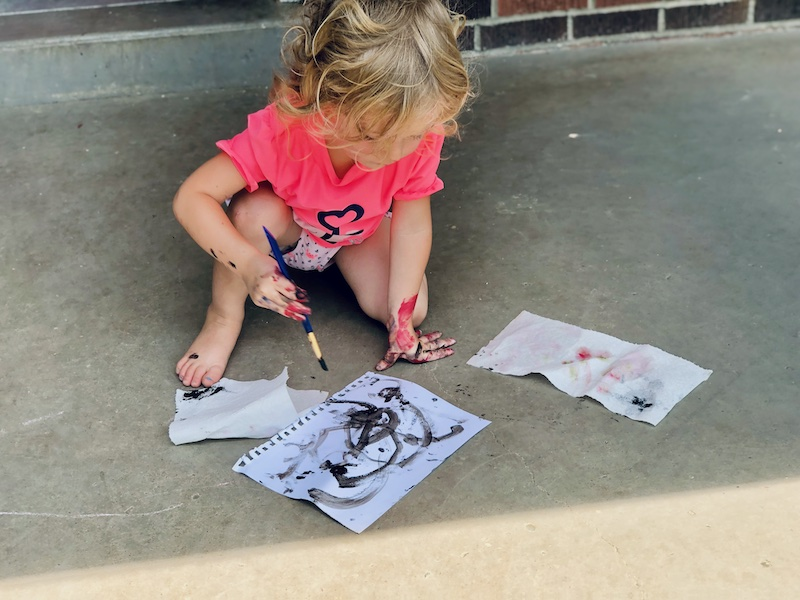 Toddler painting with black paint