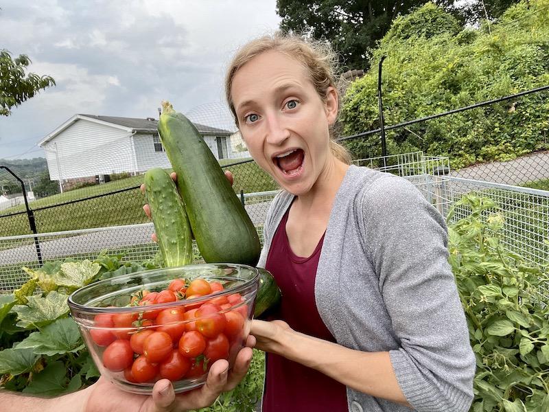 Girl holding garden produce from vegetable garden