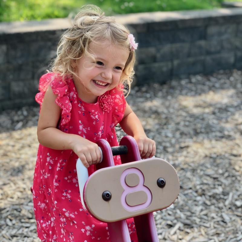 Toddler playing at playground