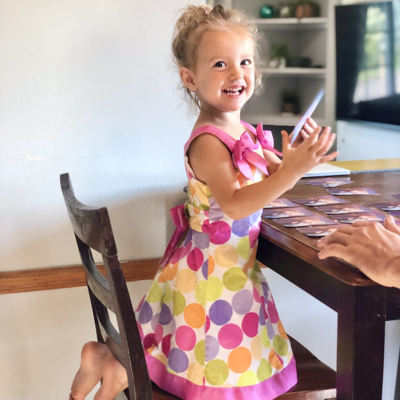 Toddler girl wearing dress with polka dots