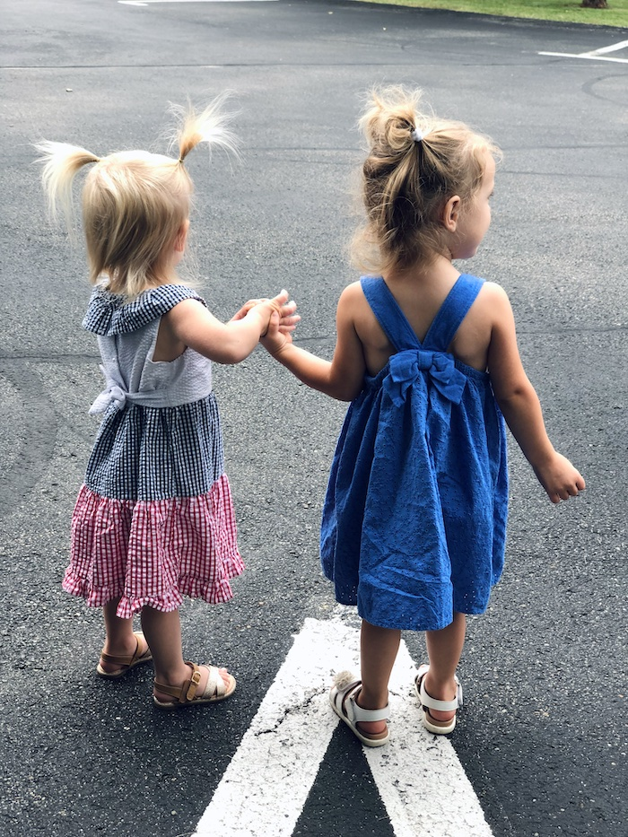 Toddlers holding hands in Fourth of July dresses