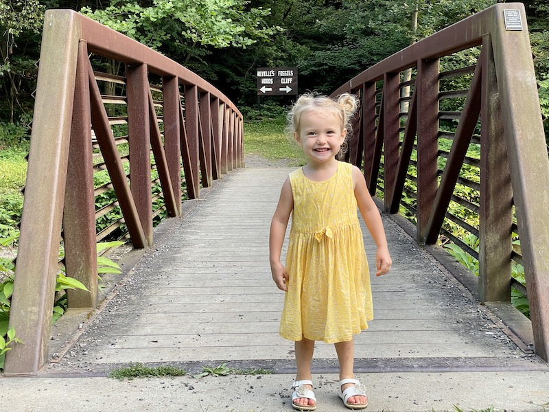 Toddler standing on bridge at Panhandle Trail in Pittsburgh, PA