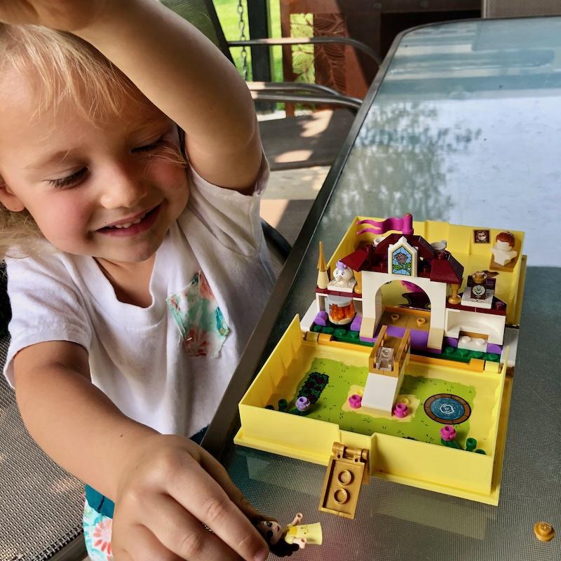 Toddler girl playing with Disney Princess Lego Kit