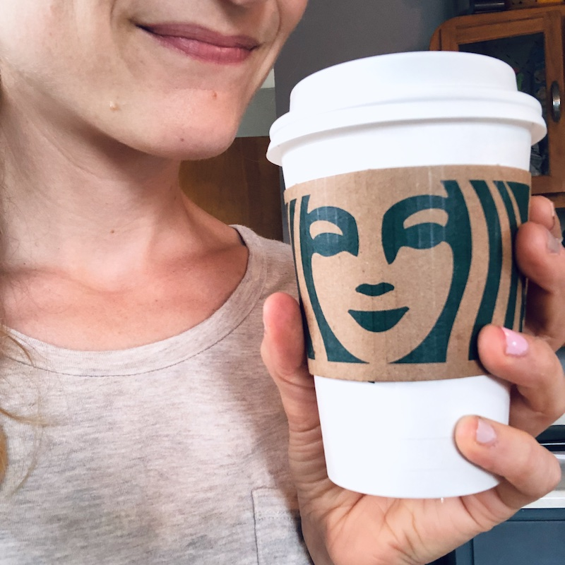 Close up of Starbucks coffee to go mug with sleeve
