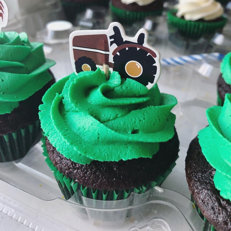 Tractor themed farm cupcake with green frosting and tractor topper
