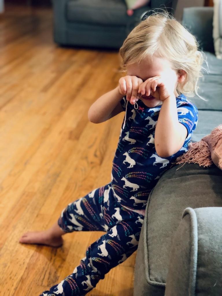 Toddler girl in unicorn pajamas