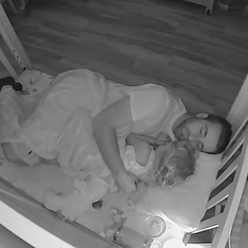 Dad laying with toddler in small bed